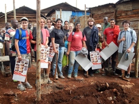 """One of ISK's """"Under Construction"""" teams. These dedicated student volunteers helped to erect the new school houses in the Kangemi slum."""