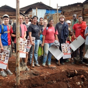 "One of ISK's ""Under Construction"" teams. These dedicated student volunteers helped to erect the new school houses in the Kangemi slum."