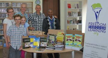 The Whall family, along with FTL co-founder Brian, present Kimuumo Secondary School visionary Peter Muthusi with the a set of textbooks for Form 1 & 2 (9th and 10th Grade) in the area of English, maths, Kiswahili and chemistry.